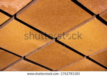 View from a low angle of bricks side by side - on a wall. The front of the brick wall photo #1762781183