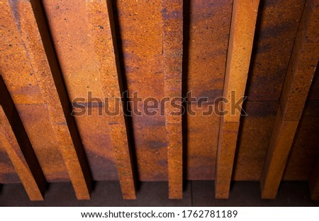 View from a low angle of bricks side by side - on a wall. The front of the brick wall photo #1762781189