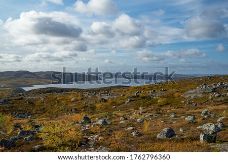 Rocky landscape against the backdrop of clouds and lakes, tundra and rocky mountains, Norway.