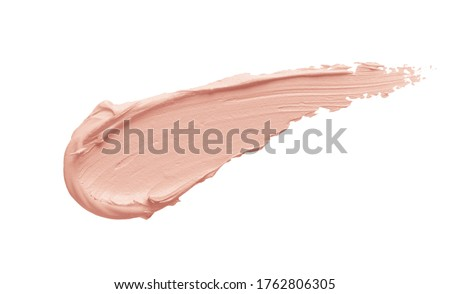 Peachy pink color correcting concealer smear smudge swatch isolated on white background. Thick cream texture. Skincare beauty product swipe closeup #1762806305