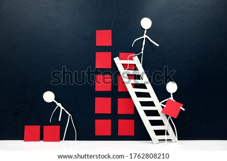 Teamwork, cooperation and rebuilding business concept. Human stick figures fixing broken building blocks. Royalty-Free Stock Photo #1762808210