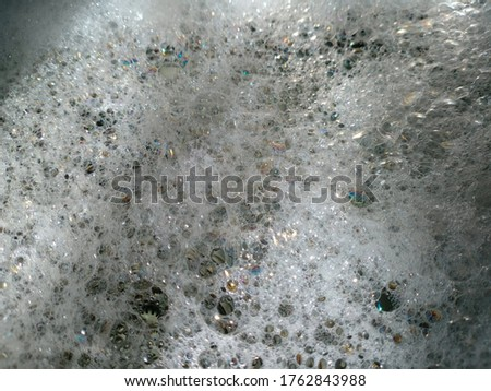 Picture of bubbles in kitchen sink in the shade of sun as background