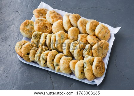 Tray with ready to eat traditional, homemade East European pies with vegetables.
