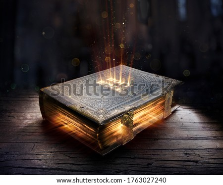 Shining Holy Bible - Ancient Book On Old Table  Royalty-Free Stock Photo #1763027240