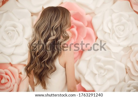 Beautiful long wavy hair style. Bride wedding hairstyle over flowers copyspace. Beauty hairdressing salon. Royalty-Free Stock Photo #1763291240