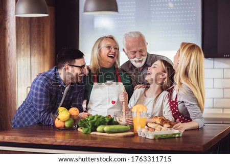 Multi Generation Family Cooking Meal At Home Royalty-Free Stock Photo #1763311715