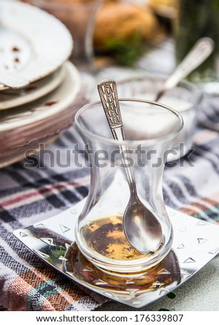 dirty glasses and plates on breakfast table