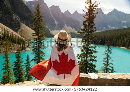 Picture of woman holding Canada flag.happy canada day. #1763424122