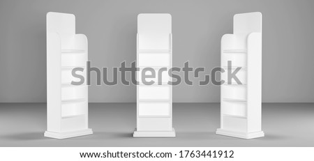 White Cardboard Floor Display Rack For Supermarket Blank Empty Displays With Shelves Products Mock Up On White Background Isolated. 3D Illustration