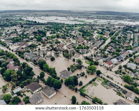 Flooded village on Ukraine. Natural disaster in village Halych, courtyards and streets in dirty water. Global catastrophe, climate change, flood concept Royalty-Free Stock Photo #1763503118