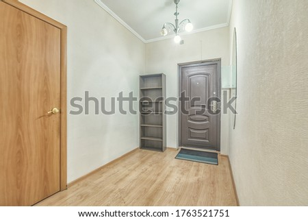 Empty residential house entrance with closed wooden doors tiny hallway #1763521751