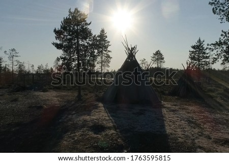 Yurt resident of the forest tundra and tundra. Yurt against the background of the forest and sunset.