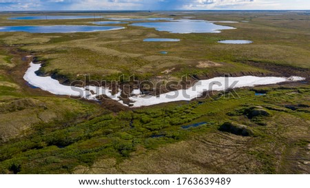 Landscape of the forest-tundra and the sandy river bank, bird's eye view.Arctic Circle, tunda. Beautiful landscape of  tundra from a helicopter.