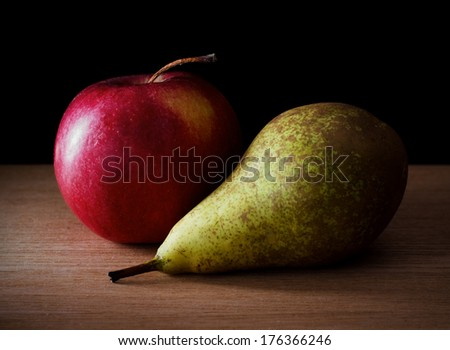 Still life photo of red apple and pear on table #176366246