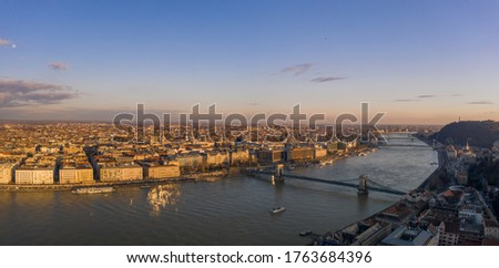 Aerial panoramic drone view of Danube river with bridges in Budapest during sunset hour in winter #1763684396