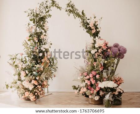 flowers wedding archs bohemian style.Wedding ceremony arch with flowers in rustic style. Wedding ceremony with fresh flowers Royalty-Free Stock Photo #1763706695