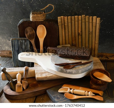 Wooden products, props for food photography. Chopping boards of different sizes, textures and colors, scoops for spices and sugar, spoons, forks, saucers, bamboo Mat. Do it yourself..
