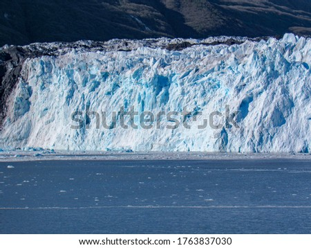 Picture of white and blue glacier at a National Park in Alaska.