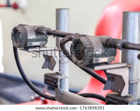 Temperature transmitter for measuring instrument close up in industry zone at power plant. Royalty-Free Stock Photo #1763898281