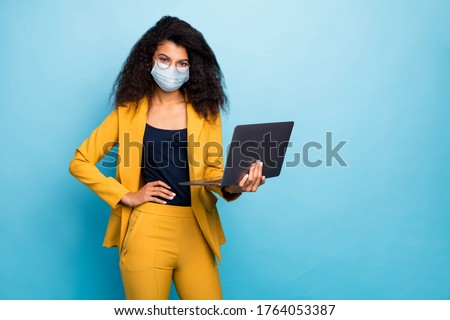 Photo of her she attractive chic classy lady using laptop wearing safety mask mers cov infection preventive measures working remotely from home wfh isolated blue color background #1764053387