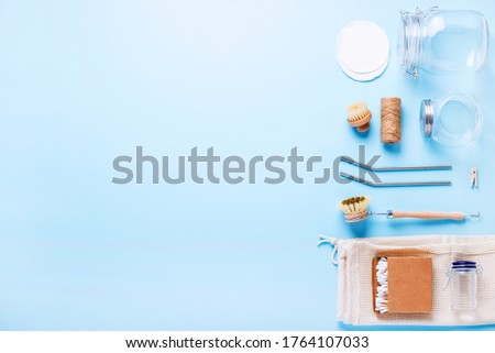 Wood and glass cleaning and hygiene items on a blue background with copy space. The concept of life without waste, and reusable. Zero waste  #1764107033
