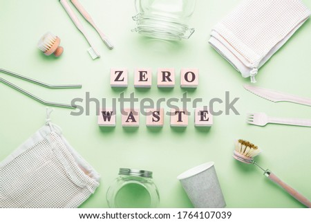 Objects of cleaning and hygiene from wood and glass on a green background. The concept of life without waste, and reusable. Zero waste inscription #1764107039