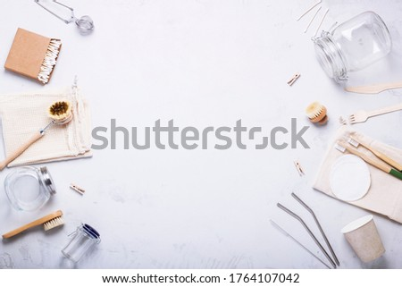 Objects of cleaning and hygiene from wood and glass on a concrete background with copy space. The concept of life without waste, and reusable. Zero waste #1764107042