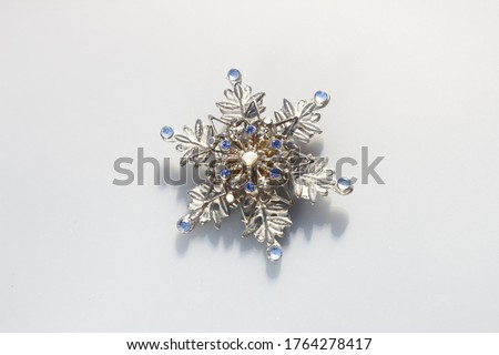 Snowflake silver tone vintage brooch with rhinestones Royalty-Free Stock Photo #1764278417
