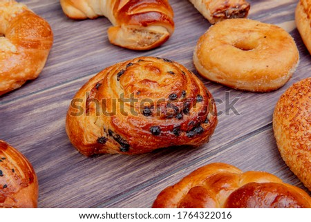 side view of pattern of different bakery products on wooden background #1764322016