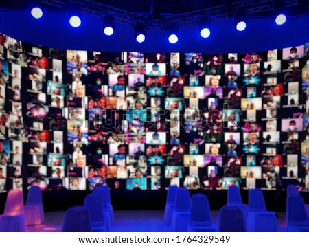Blurred LED screen of many people faces join big online  event or live conference.Work at home.Video online conference.Social distancing in state quarantine.New normal event production.Online meeting  #1764329549