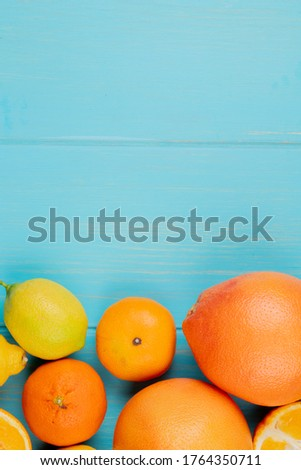 top view of citrus fruits as orange lemon and tangerine on blue background with copy space #1764350711