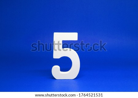Five ( 5 ) white wooden  Isolated blue Background with Copy Space - New promotion 5% Percentage  Business finance Concept - Number Object  #1764521531