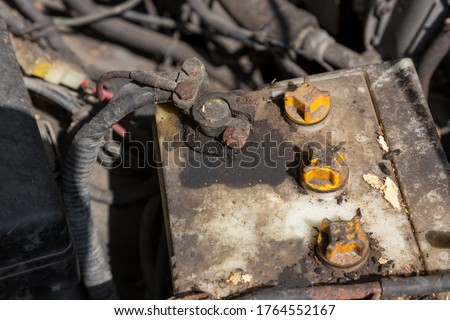 Oxidized and dirty car battery terminal. Battery terminals corrode dirty damaged problem. Old battery corrosion deteriorate leaking with acid powder. #1764552167