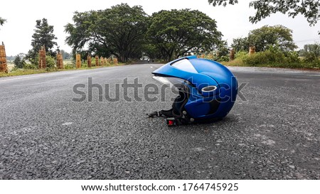 helmet on the middle of road Royalty-Free Stock Photo #1764745925
