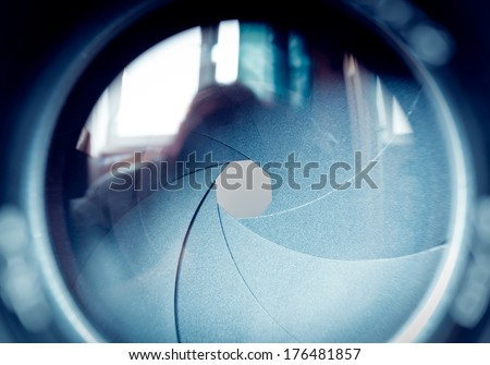 The diaphragm of a camera lens aperture. Selective focus with shallow depth of field. Color toned image. #176481857