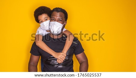 Portrait of  African American father with toddler son using mask. Father and son wearing mask to protect covid 19, quarantine. Stay at home concept. Fathers day!  #1765025537