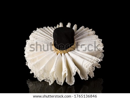 Display of an Elizabethan lace ruff collar Royalty-Free Stock Photo #1765136846