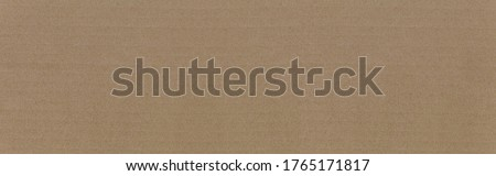 Panorama of Cardboard texture top view. Brown paper background closeup. Paper texture brown sheet absrtact background. Light brown wrapping texture