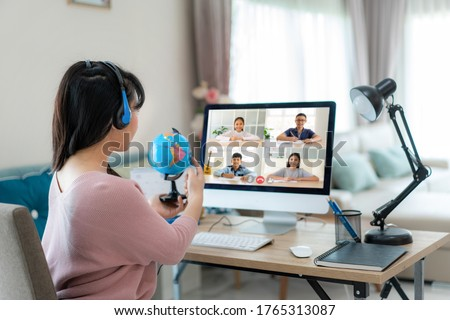 Asian woman teacher teaching geography via video conference e-learning and cheerful elementary school student looking at globe, Homeschooling and distance learning ,online ,education and internet. #1765313087