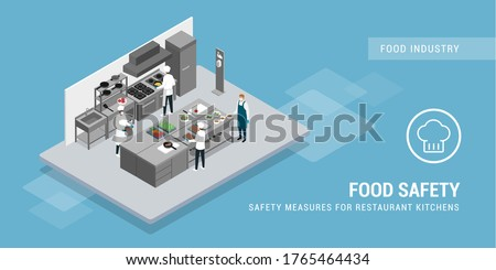 Chefs working in the kitchen restaurant following safety measures during coronavirus epidemic Royalty-Free Stock Photo #1765464434