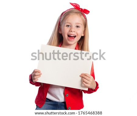 Beautiful European blonde girl with a white piece of paper on a white background. Space for text, banners, labels, and ads.