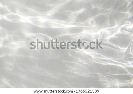 Water texture overlay effect for photo and mockups. Organic drop diagonal shadow and light caustic effect on a white wall. Shadows for natural light effects #1765521389