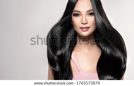 Beautiful asian model girl with shiny black and straight long hair . Keratin straightening . Treatment, care and spa procedures for hair . Chinese girl with smooth hairstyle #1765573874