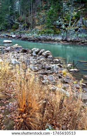 Water autumn landscape. A shallow fast mountain river with a rocky bottom. Ural. #1765610513
