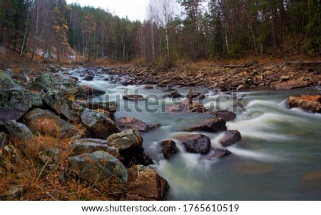 Water autumn landscape. A shallow fast mountain river with a rocky bottom. Ural. #1765610519