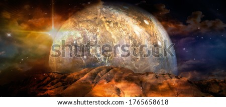 Beautiful multicolor landscape of an alien planet. Elements of this image furnished by NASA. Royalty-Free Stock Photo #1765658618