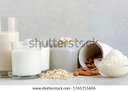 Various vegan plant based milk with ingredients Royalty-Free Stock Photo #1765715606