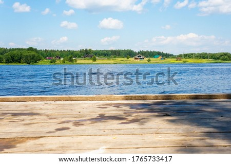 Wooden pier on a lake scene, horizontal view with a beautiful rustic background #1765733417