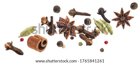 Aromatic spices collection, christmas decoration, falling igredients for mulled wine isolated on white background Royalty-Free Stock Photo #1765841261