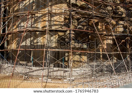Scaffolding steel frame used as the temporary structure to support building structure during construction, Business Architecture and Construction Industry Under Constructed and Safety First Concept #1765946783
